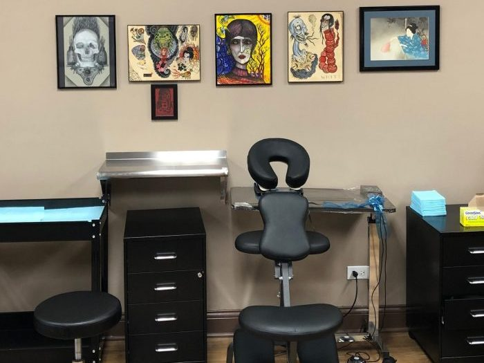 interior tattoo shop image of chair for back tattoo