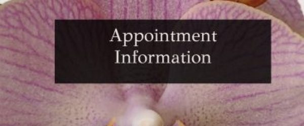 an orchid behind a dark rectangle with appointment information written